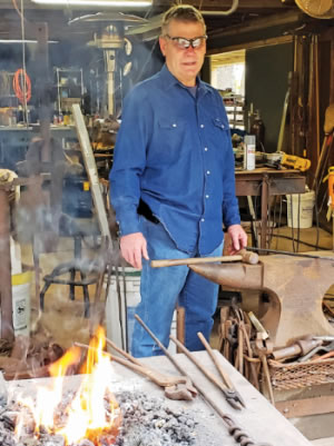 Al Clark at his home forge in richmond and just a few of his  projects, including candelabras and depictions of Kokopelli.