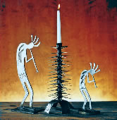 A few of Al Clark's projects, including candelabras and depictions    of Kokopelli.