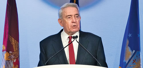Dan Rather at a Podium Speaking to Audience