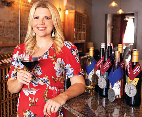Photo of Elizabeth Hill Holding a glass of wine