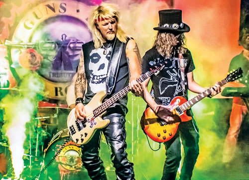 Nathan Majors and Matt Smith perform as Guns N' Roses onstage.
