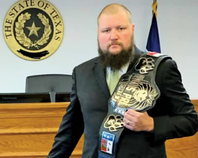 Jay Rudinger shoulders the Lions Pride Sports championship  belt in the courtroom.