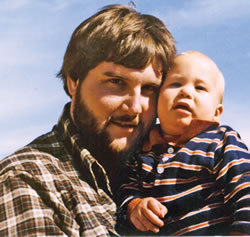 Tom Vick Holding His Young Son