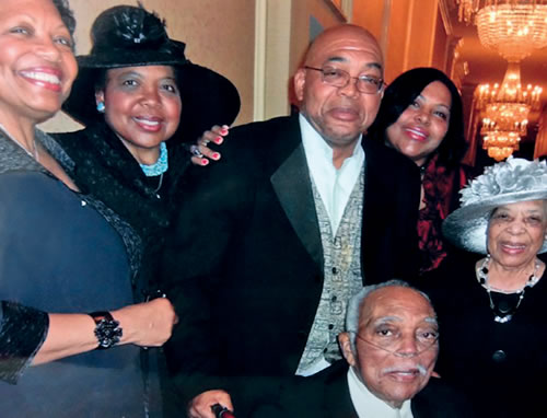 Picture of retired chief justice carolyn wright in a group picture  with her family at an event
