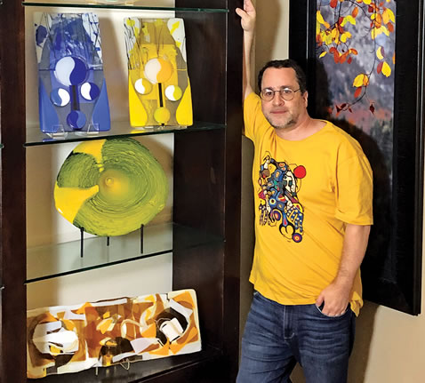 Stephen Weinberg Standing Next to Some of His Glass Pieces