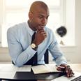 image of Businessman_atDesk_onLaptop